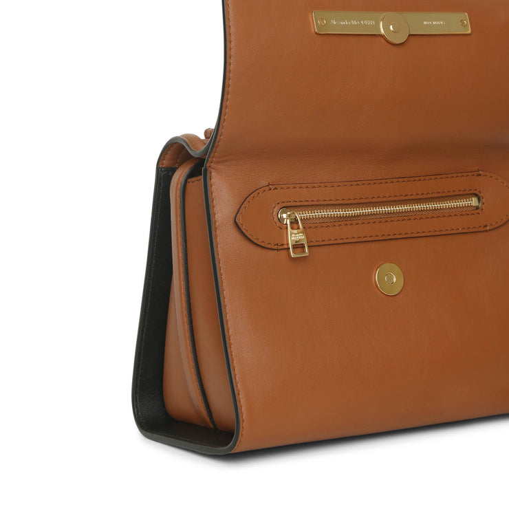 The Story whipstitch brown leather bag