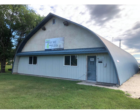 Enter through the front doors of the blue Quonset