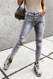 Trendy Low-Rise Ripped Fringed Jeans