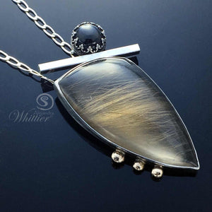 Rutilated Quartz and Black Star Diopside Pendant