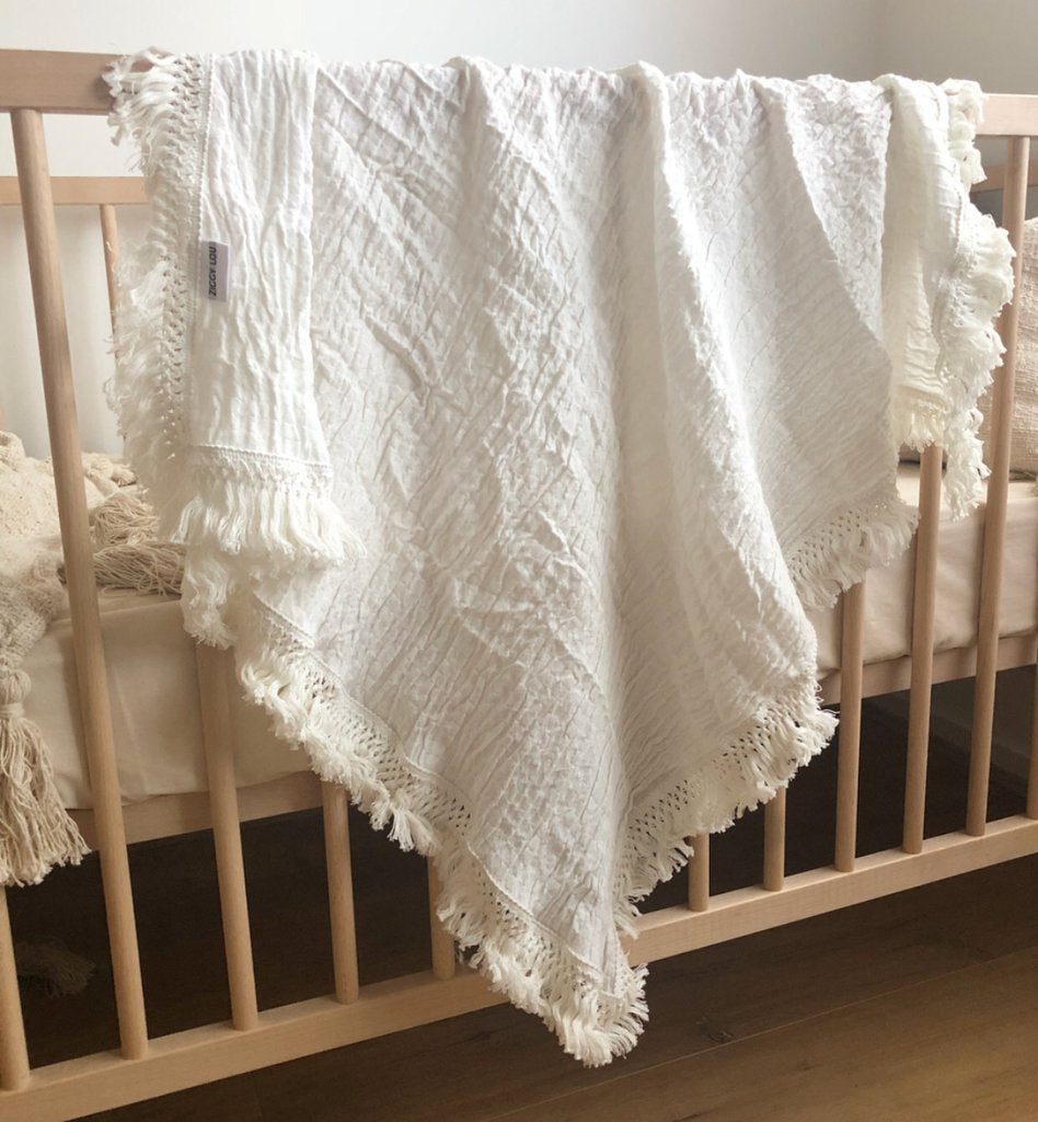 Cream swaddle with cream fringe