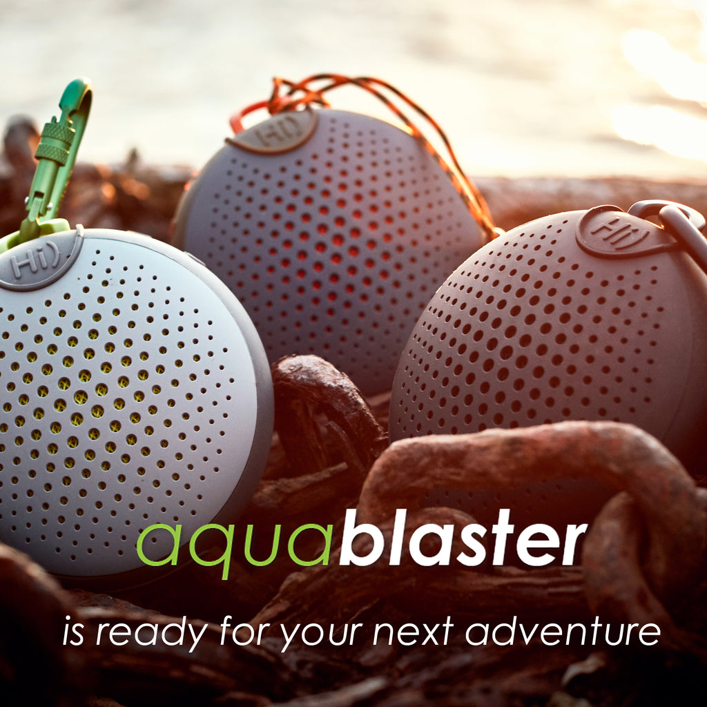 array of aquablaster speakers in the rocks at a beach
