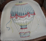 English child's chair with upholstered hot air balloon pattern