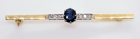 18 Ct gold Sapphire and diamond bar brooch