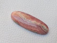 Load image into Gallery viewer, 35x14x7 mm Natural Rhodochrosite Oval Shape