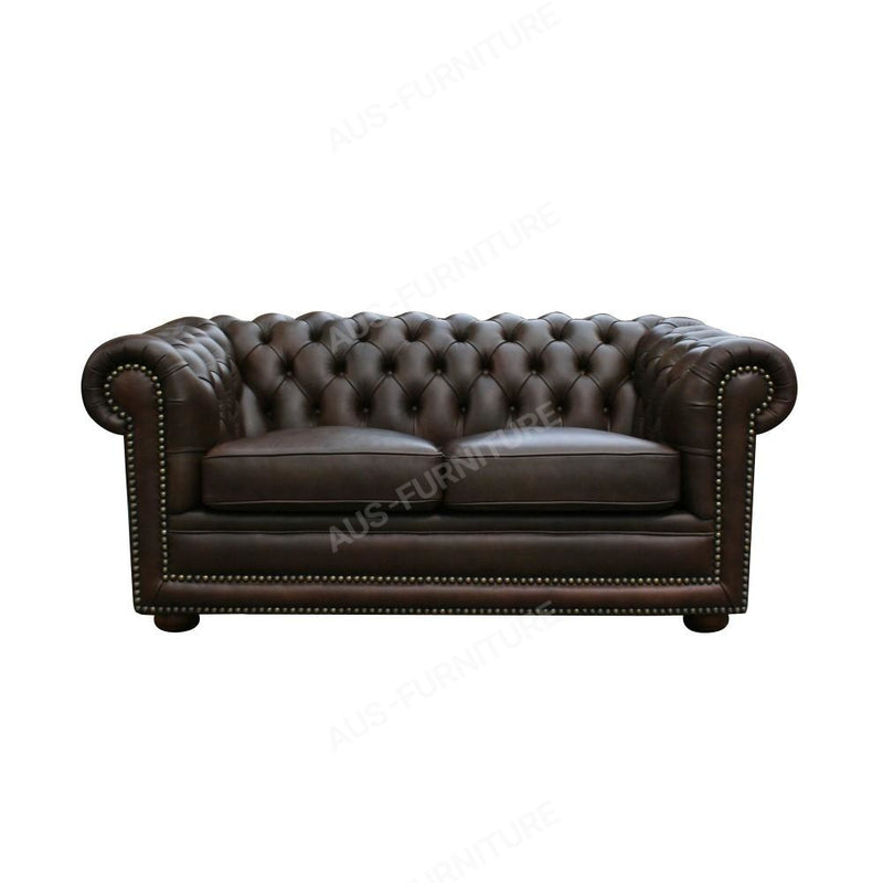 a black leather couch sitting on top of a couch