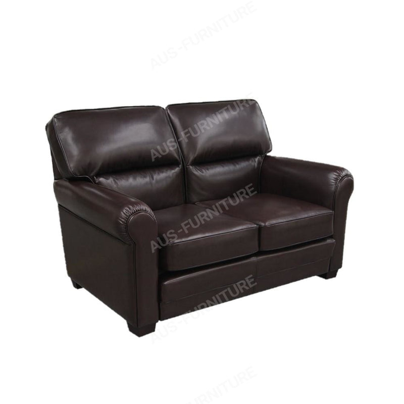 a brown leather couch sitting on top of a table