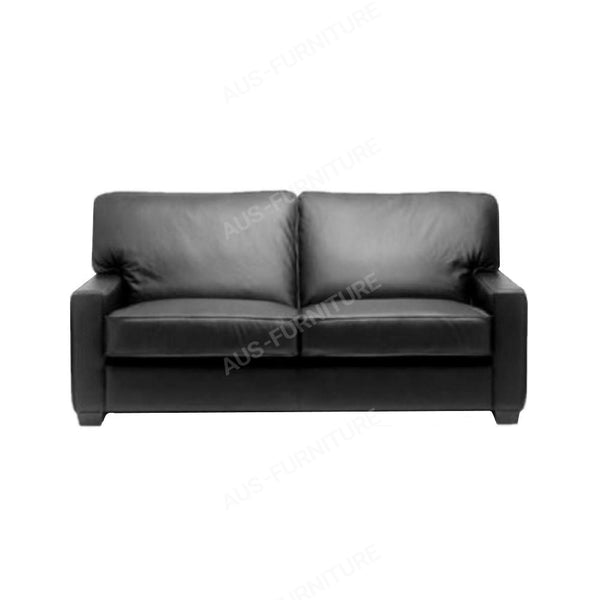 a black couch sitting on top of a table