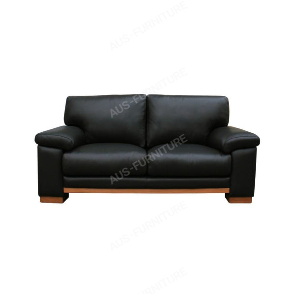 a black leather chair sitting in a room