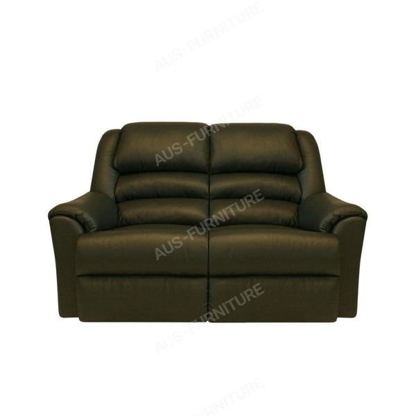 a black leather couch sitting on top of a table