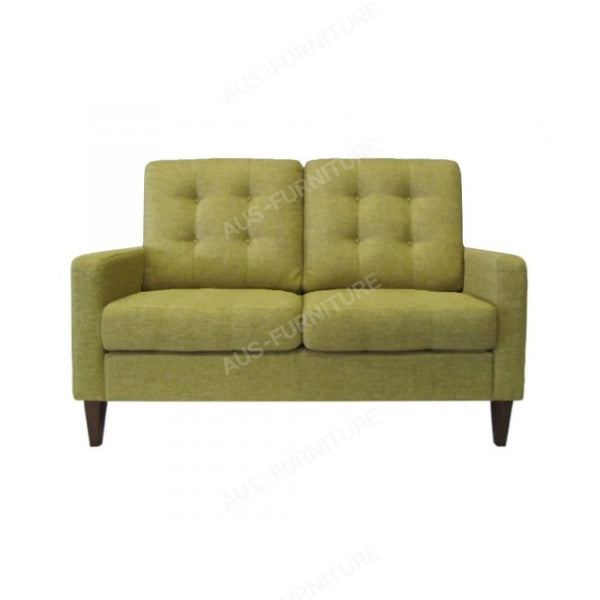 a green couch sitting on top of a table