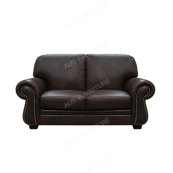 a black leather leather chair sitting in a room