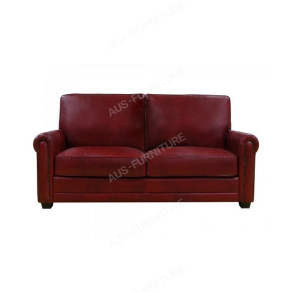 a red leather couch sitting on top of a couch