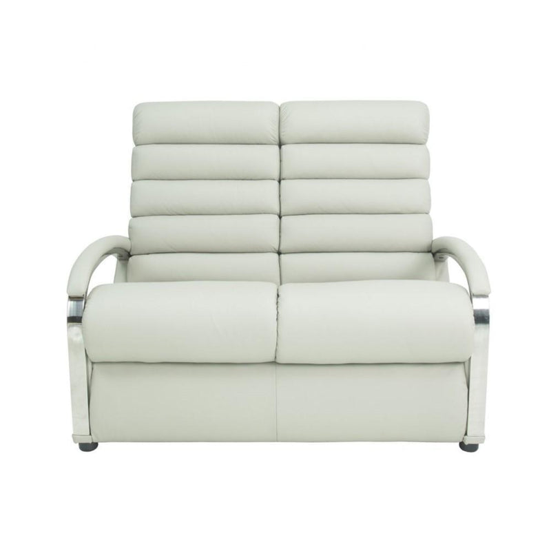 a white couch with a white blanket on top of it