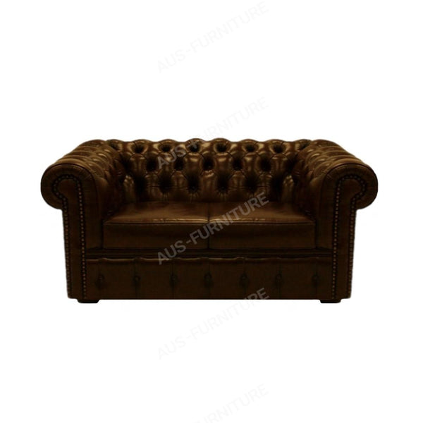 a brown couch sitting on top of a couch