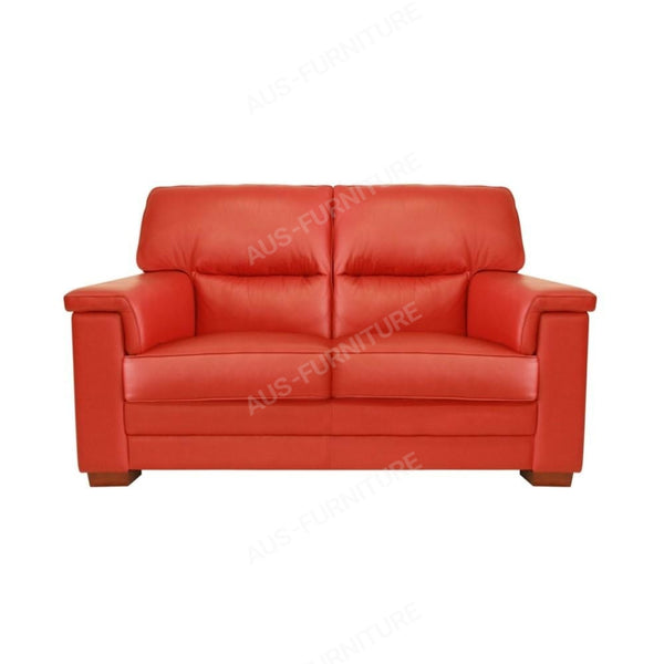 a red couch with a red blanket on top of it