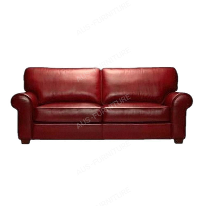 a red leather couch sitting in a room