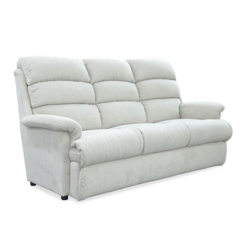 a white couch with a white blanket on it