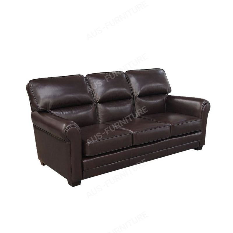 a black leather couch with a brown suitcase on it