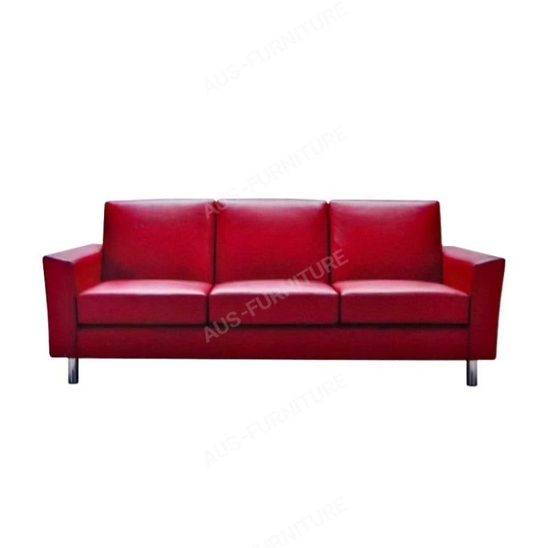a red couch sitting in a living room