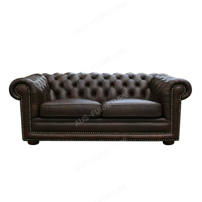 a black leather couch with a black and white pillow