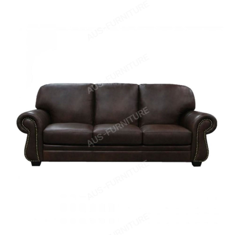 a black leather couch sitting in a room