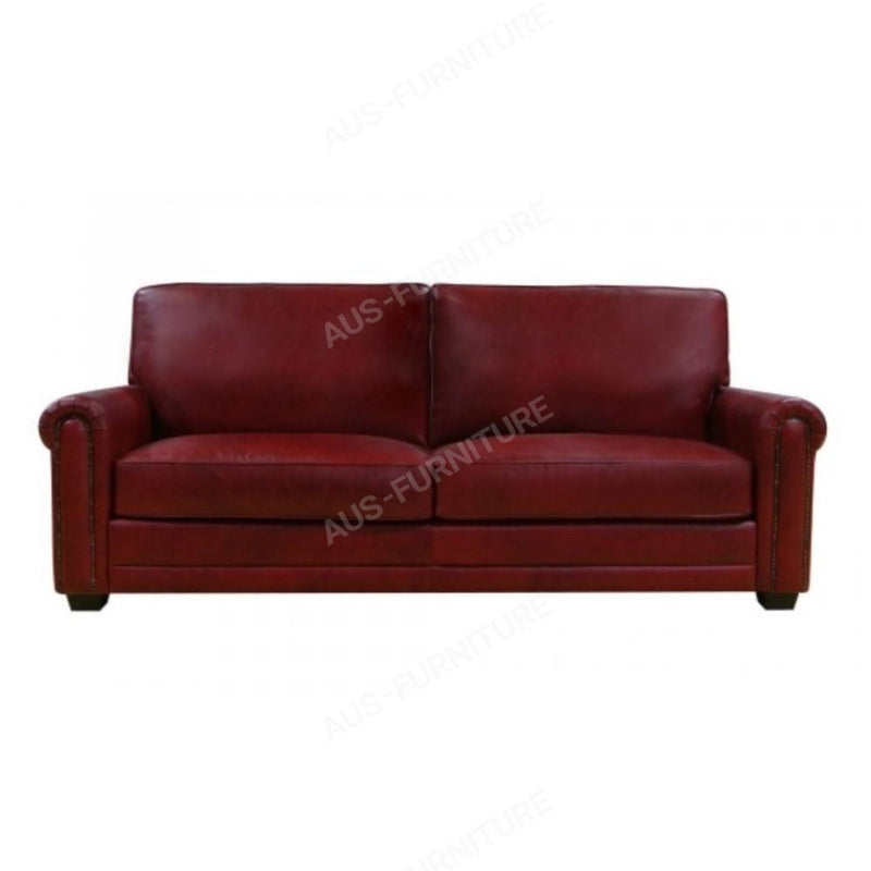 a red leather couch sitting in a living room