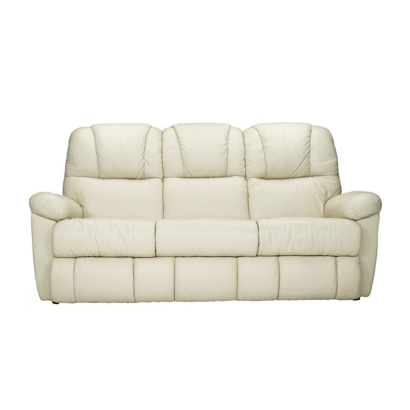 a white couch with pillows on it