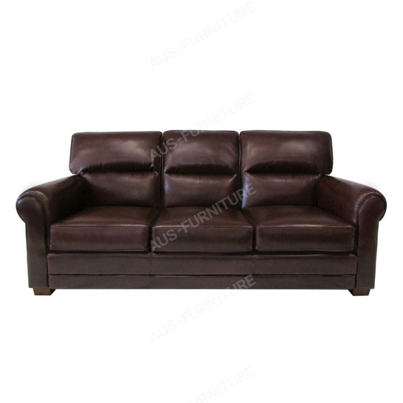 a brown leather couch sitting in a room