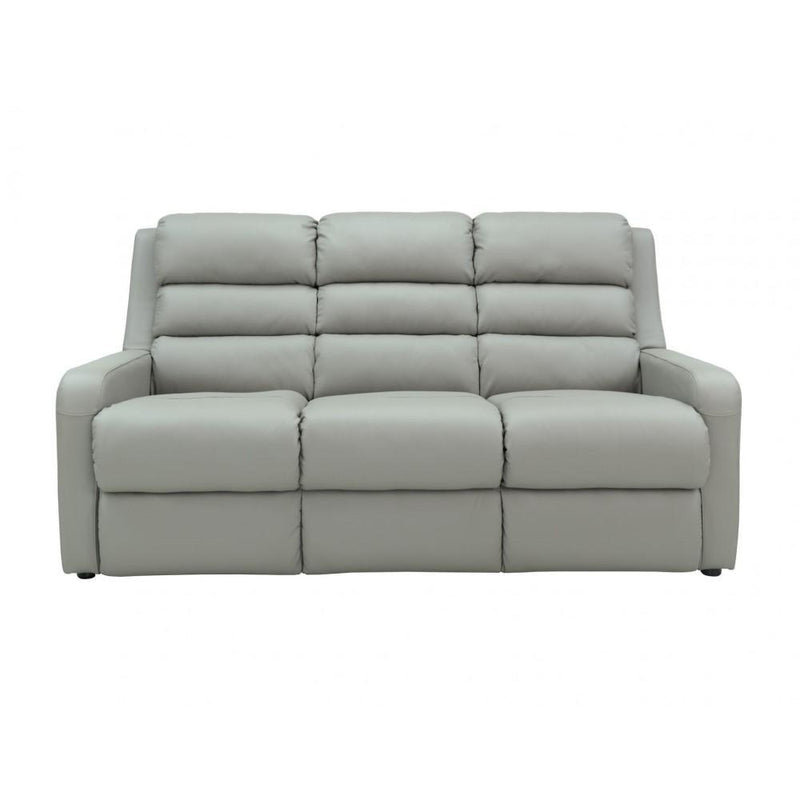 a white couch with pillows on top of it