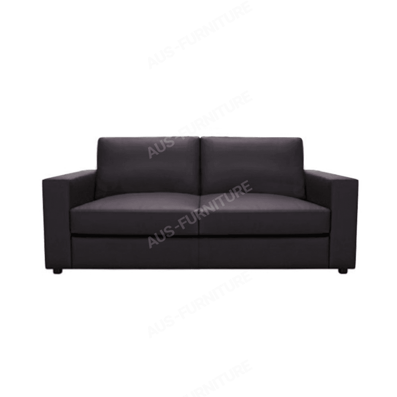 a living room with a black leather couch