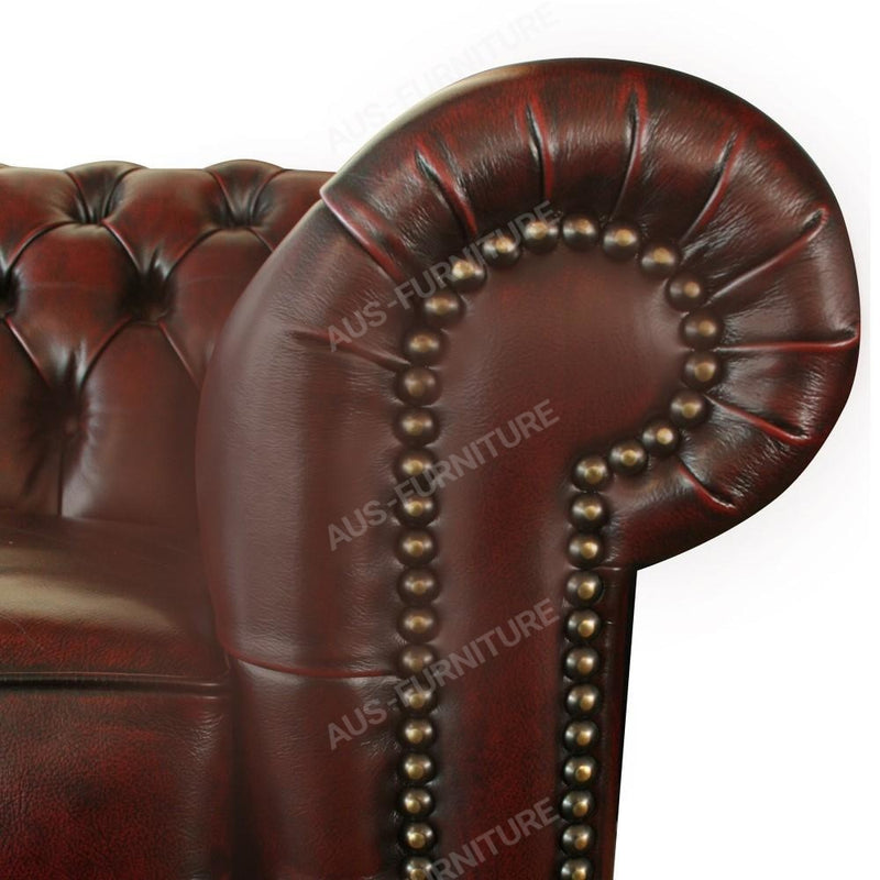 a close up of a baseball glove on a couch