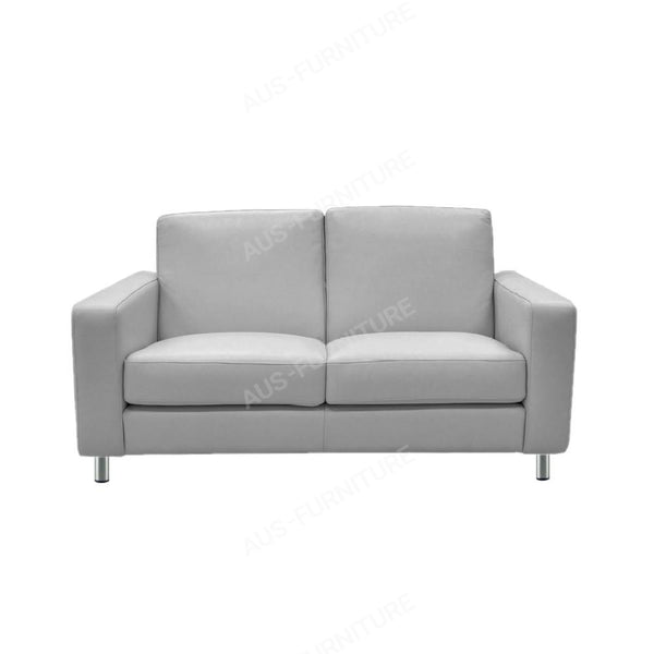 a white couch sitting on top of a white couch