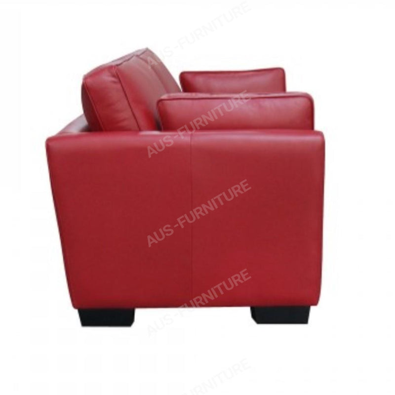 a red piece of luggage sitting on top of a table