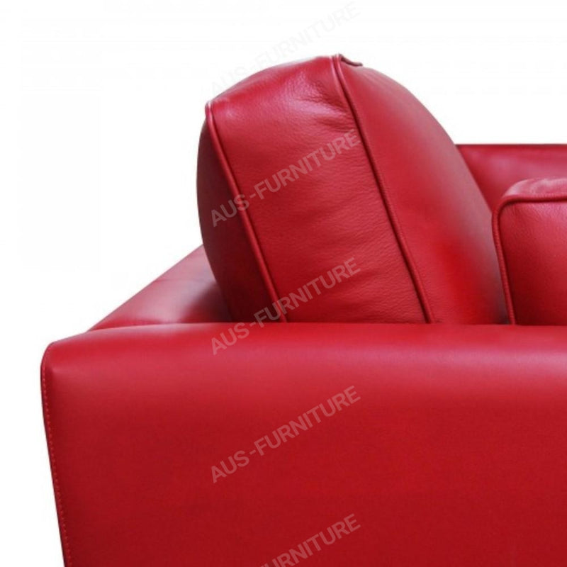 a red suitcase sitting on a red chair