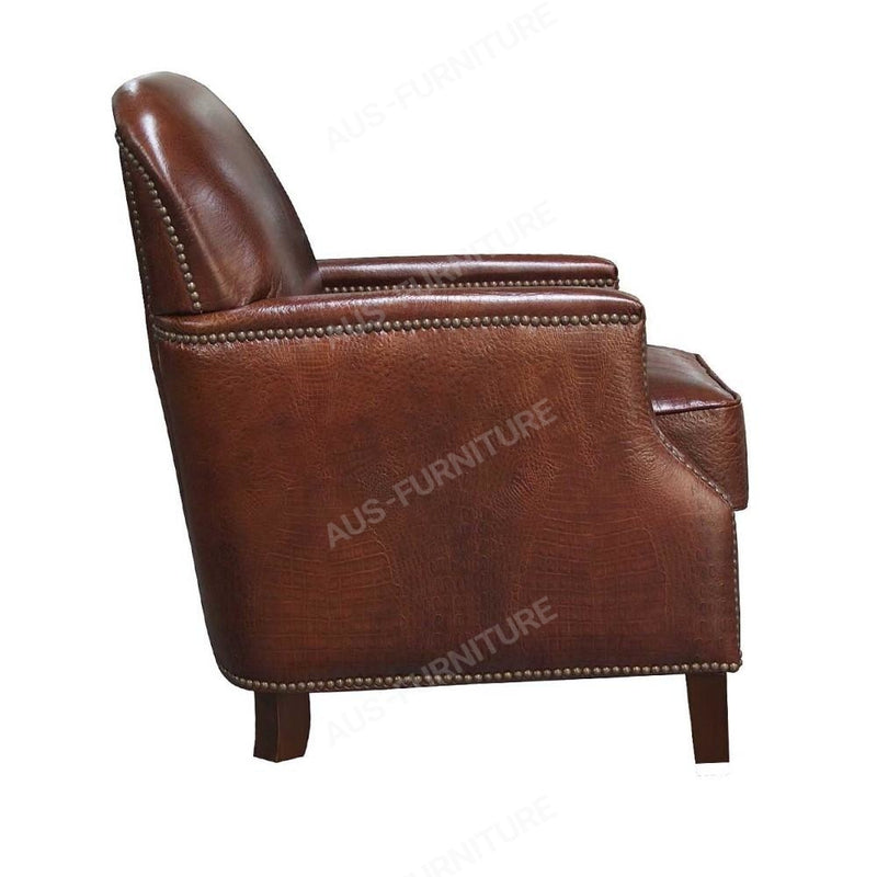a brown leather suitcase sitting on a chair