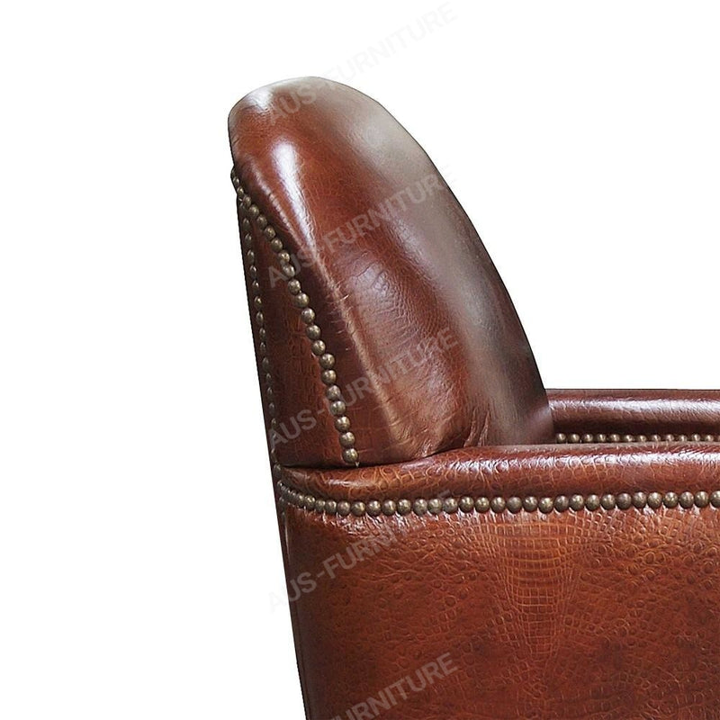 a brown leather chair with a brown shoe and a brown chair