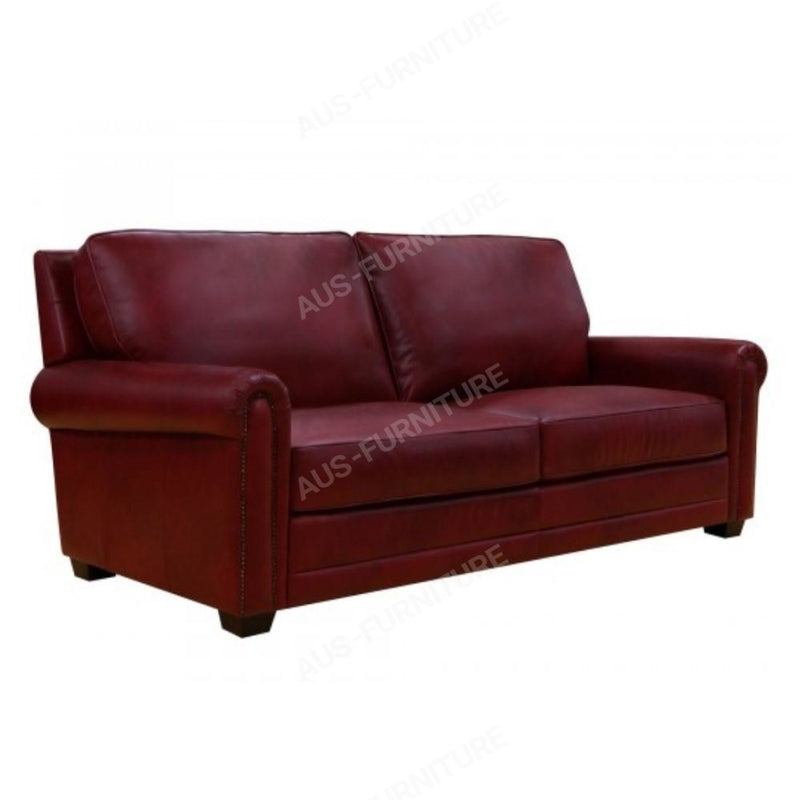 a brown leather couch sitting on top of a couch