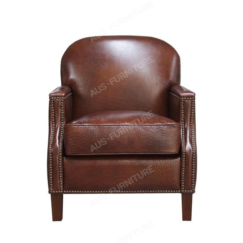 a brown leather chair sitting in front of a brown chair