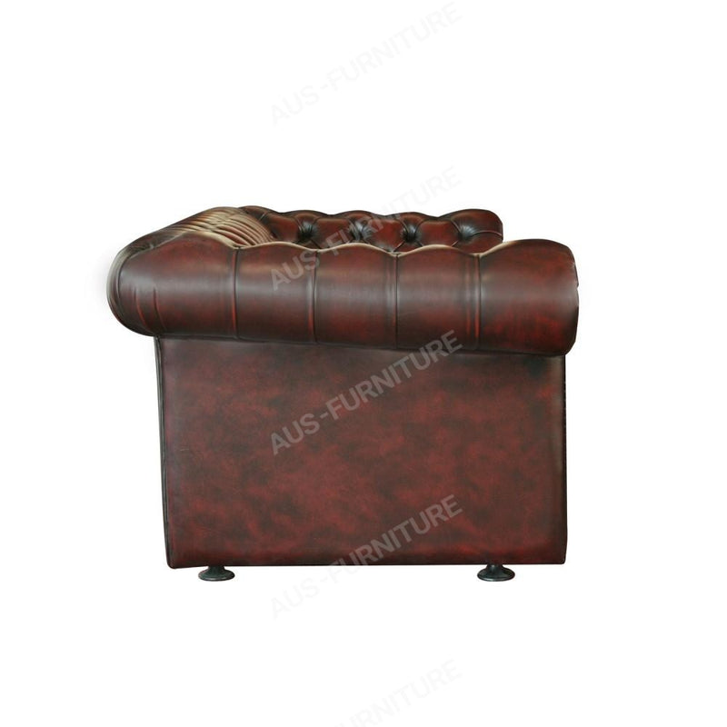 a brown piece of luggage sitting on top of a table