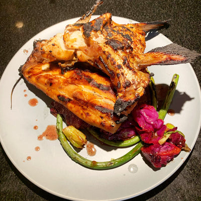 Wulf's Kitchen: Grilled Striped Bass Fillets and Collars with Cabbage, Scallions, & Scapes
