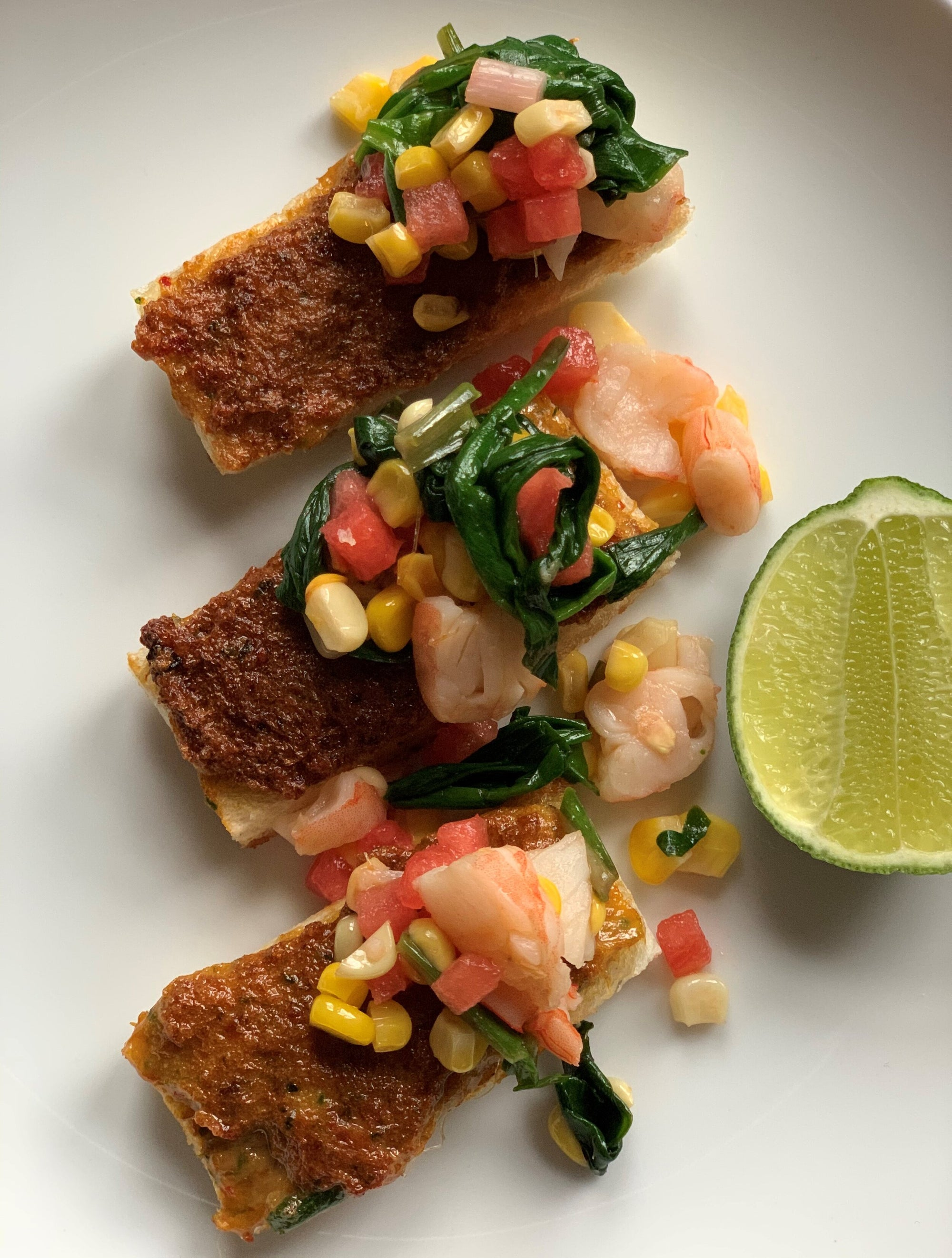 Chefs at Home: Harissa Shrimp Toast with Grilled Corn and Ramp Salad