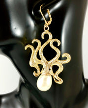 "Load image into Gallery viewer, Enlarged picture of Texture Octopus with Pearl Accent Dangle Earrings Color: Gold/White Approx. 2.8"" Length x 1.5"" Width Lever Back"