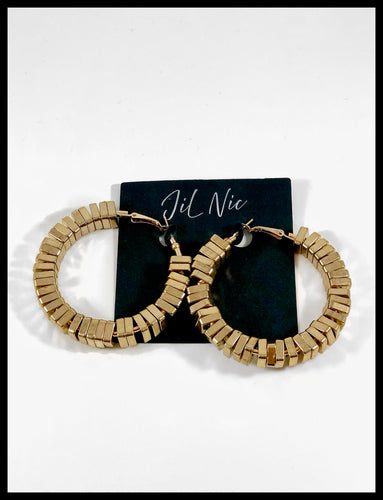 Medium sized gold hoop with stackable square moveable pieces located on the earring. Has a click back closure.