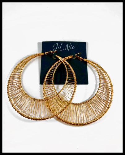 Oversized circle fan hoop in gold. Approximately 3.3