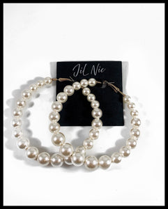 "Image of Gradual Pearl Beaded Hoop Earrings Color: Ivory/Gold Approx. 3.0"" Length x 3.25"" Width Clip Back"