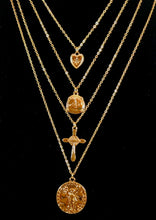 "Load image into Gallery viewer, Magnified image of the set of four gold necklaces that can be layered or worn separately. Set includes Heart Charm with Rhinestone North Star Necklace, Compass Charm Necklace, Cross Charm Necklace, and Coin Charm Necklace.  Approximately 16-18-20-22"" Length, with Clasp Closure with 3"" Ball Extension."