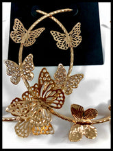 "Load image into Gallery viewer, Detail picture of Butterfly Embellished Hoop Earrings  Color: Gold Approx. 3.0"" Length x 3.0"" Width Post Back"