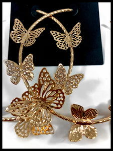 "Detail picture of Butterfly Embellished Hoop Earrings  Color: Gold Approx. 3.0"" Length x 3.0"" Width Post Back"