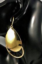 "Load image into Gallery viewer, Magnified image of a Gold double teardrop open drop earrings. Approximately 3.5"" Length x 2"" Width, with a post back."